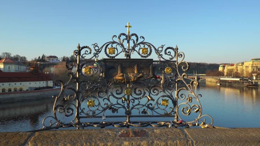 Saint Jan Nepomucky at Charles Bridge in Prague. Golden symbol of a man thrown into the river Vltava, touch it for good luck. Czech Republic. | Shutterstock HD Video #1050036790