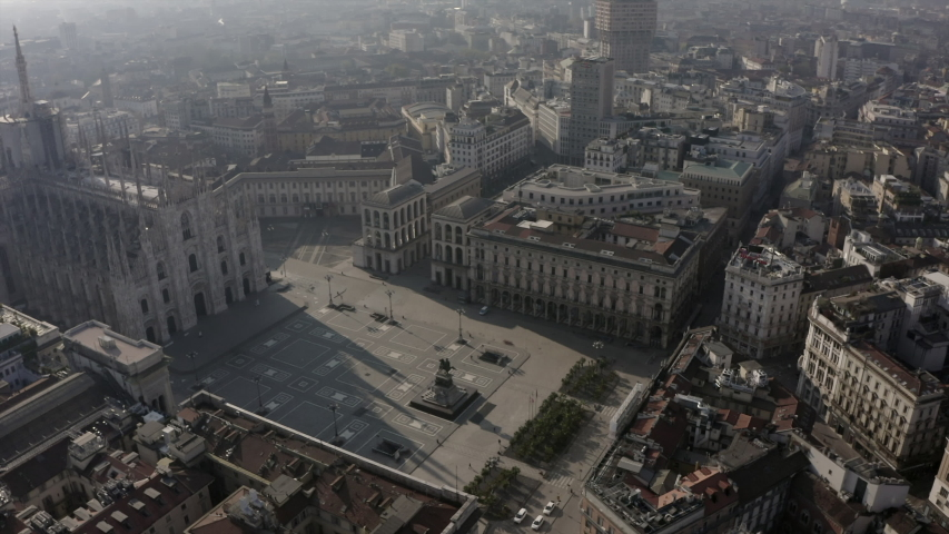 Everyday life in Milan, Italy during COVID-19 epidemic. Milano, Italian city and coronavirus lockdown. Aerial view of Piazza Duomo with church and square seen from drone flying in sky | Shutterstock HD Video #1050081670