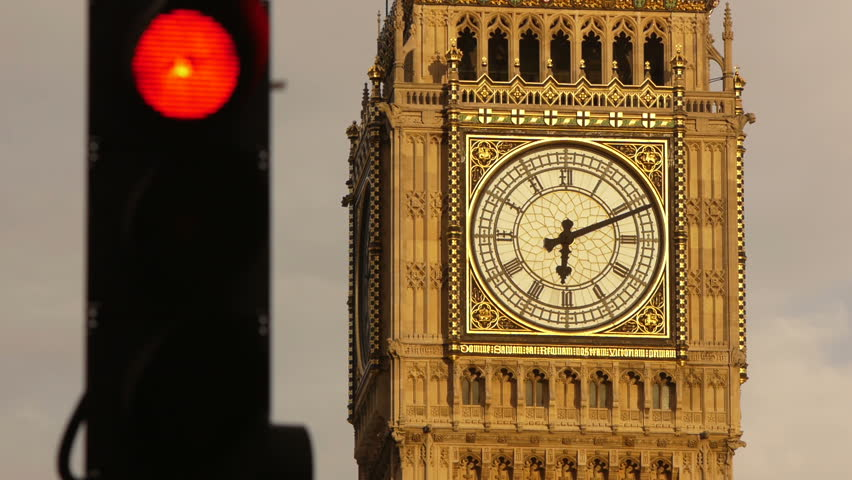 London big Ben clock face with traffic lights