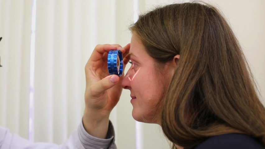 Ophthalmologist Examines Woman Eye Through Stock Footage Video (100%  Royalty-free) 10507670   Shutterstock