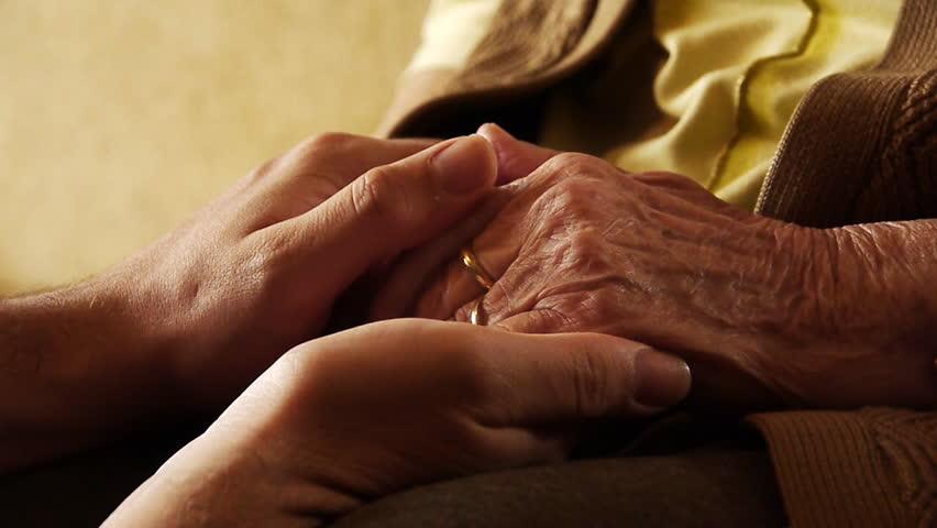 Senior Holding Hands