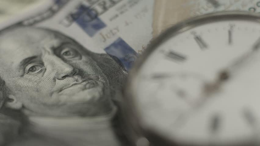U.S. one hundred dollar bill, pocket watch. Time, money system   Shutterstock HD Video #10544390