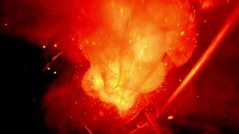 slow-motion footage of burning and explosion of gunpowder as space Like a cosmic illustrations burns and explodes gunpowder in the laboratory young alchemist, galaxies arise out of the smoke