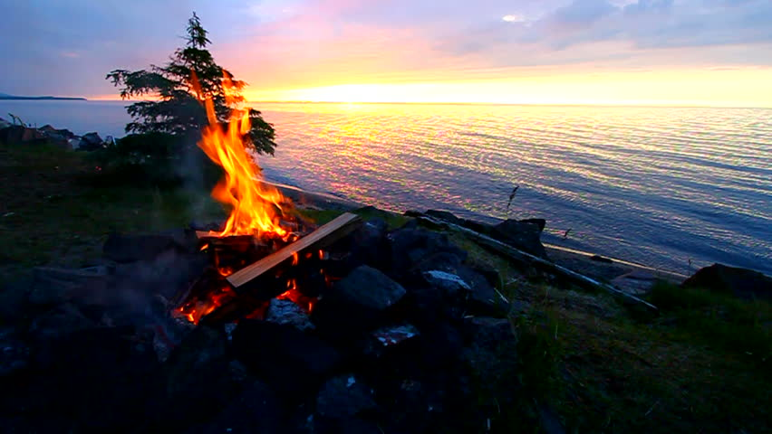 Sunset camp fire along a beautiful Great Lakes beach in northern Michigan | Shutterstock HD Video #10554470