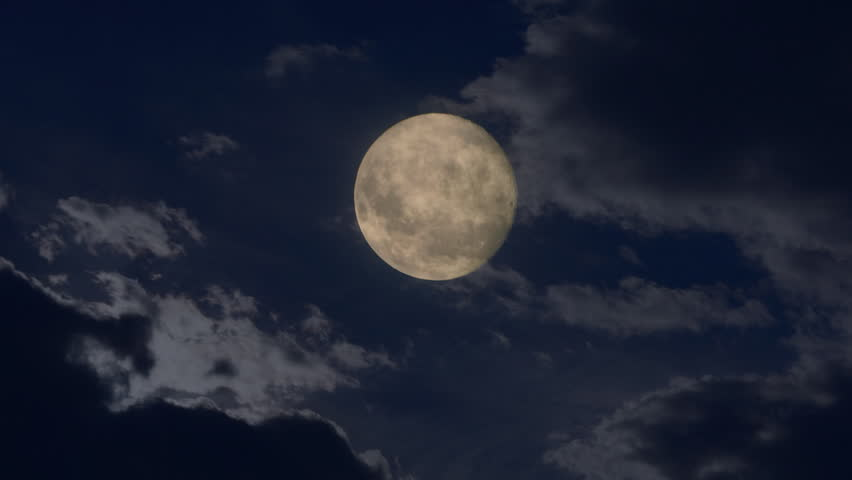 Full moon shining bright behind clouds at dark night. Time lapse | Shutterstock HD Video #10584230