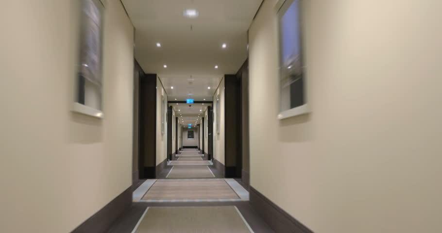Hospital Corridor Lighting Design: Woman Being Wheeled Through A Hospital Hallway On A Gurney
