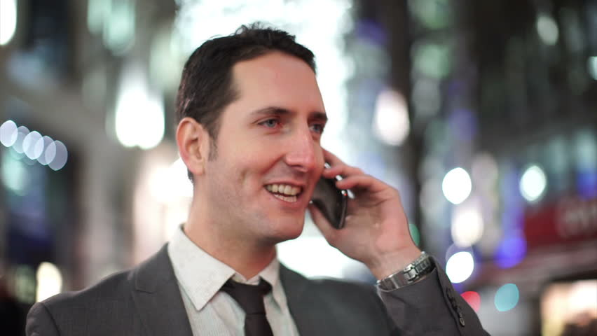4K Businessman talking on mobile phone in the city in the evening | Shutterstock HD Video #10607510