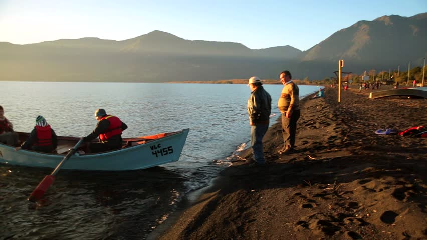 A rowing boat is launched in the Villarrica lake in Chile. All Year around, people coming here and have fun with sailing, kayaking, sport fishing and water skiing.  #10616090