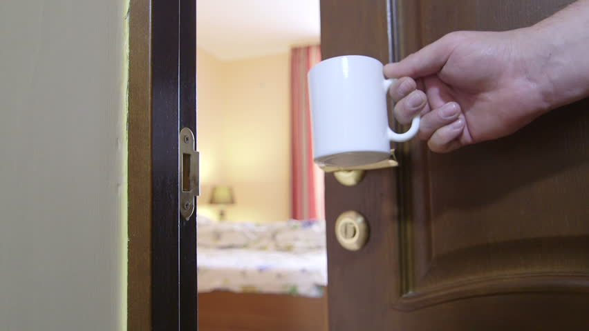 Wake up, sleeping beauty! Man's hand with cup of coffee opening door to bedroom in the morning | Shutterstock HD Video #10653500