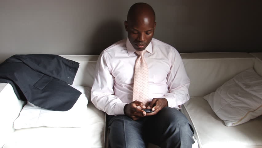 African American businessman working on smart phone