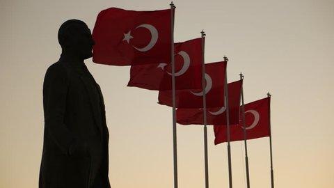 Ataturk statue and Turkish flags waving at Izmir