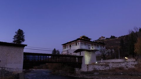 Timelapse of The Paro Rinpung Dzong and The Ta Dzong (Bhutan National Museum) from day to night in late autumn, Paro, Bhutan.
