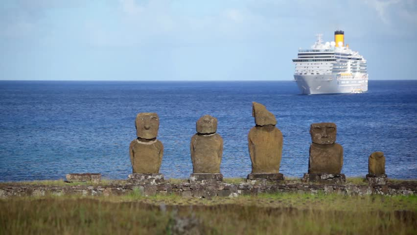 Cruise Ship Floats Off Coast Of Easter Island In View Of A Line Of Moai