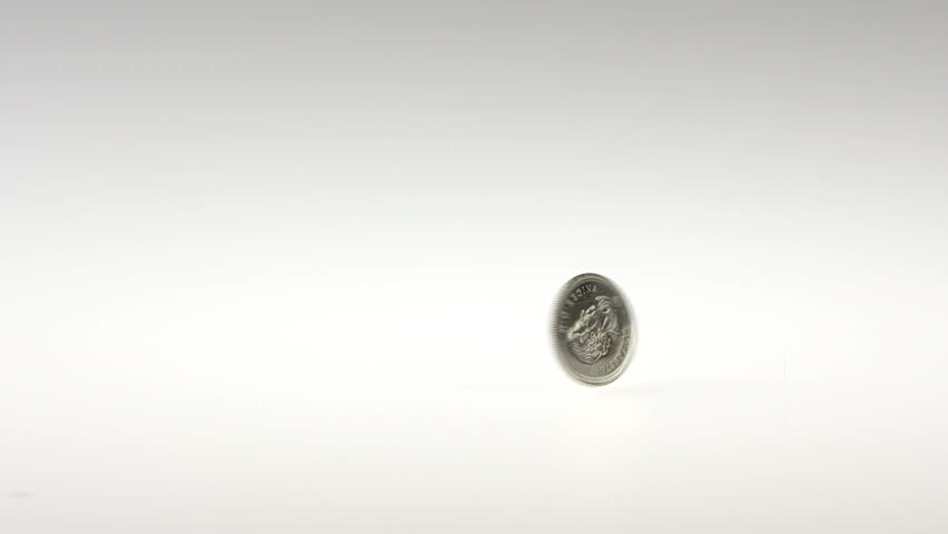 Super Slow Motion Quarter Spinning on a White Background | Shutterstock HD Video #10710440