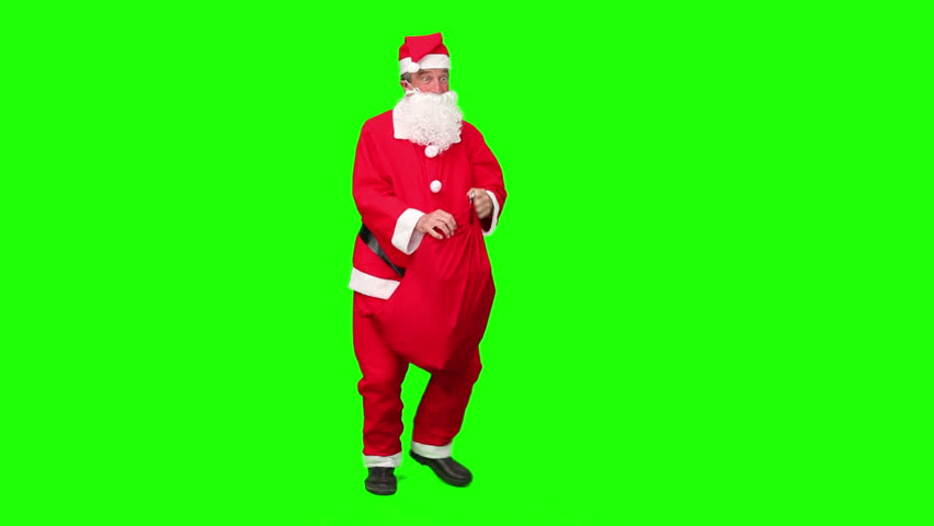 Santa Claus looking for a house against a green screen #1072960