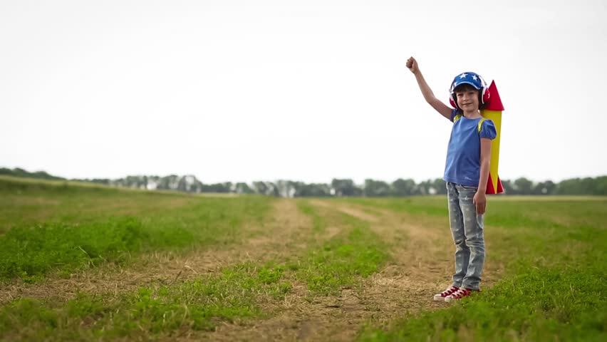 Happy kid playing in summer field | Shutterstock HD Video #10735910