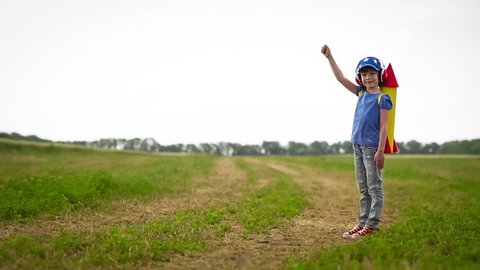 Happy kid playing in summer field