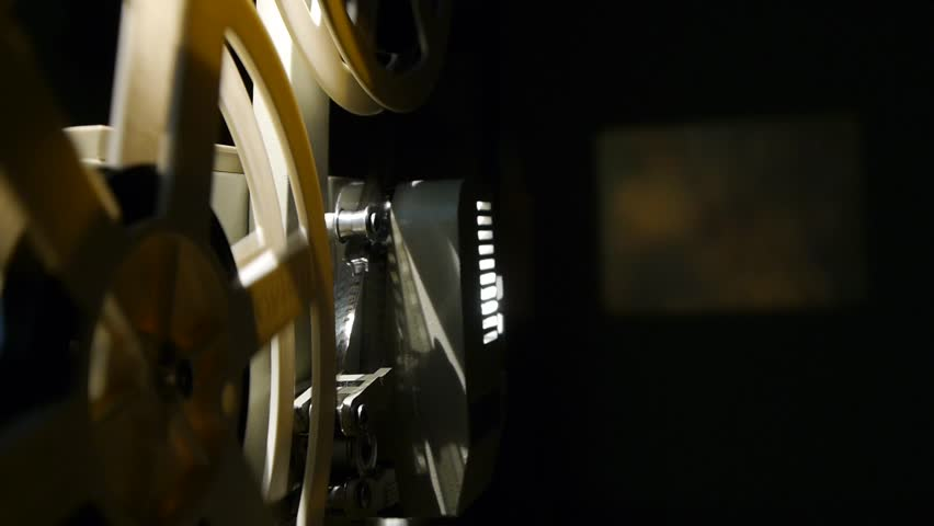 Vintage 8 Mm Movie Projector And Film Reel Closeup - Includes film projector audio