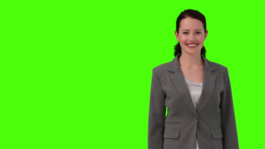 Chroma-key footage of a dark-haired woman in suit looking at the camera