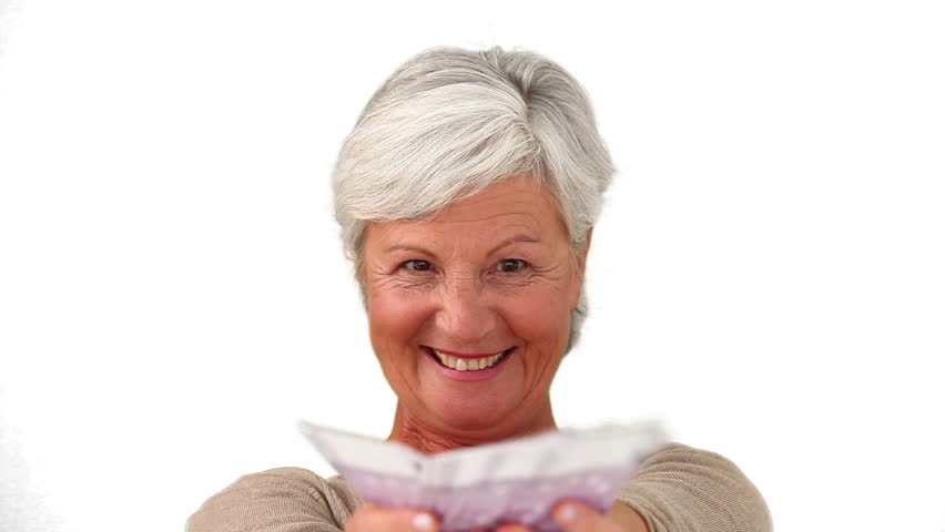 Mature woman proud of what she earned against a white background