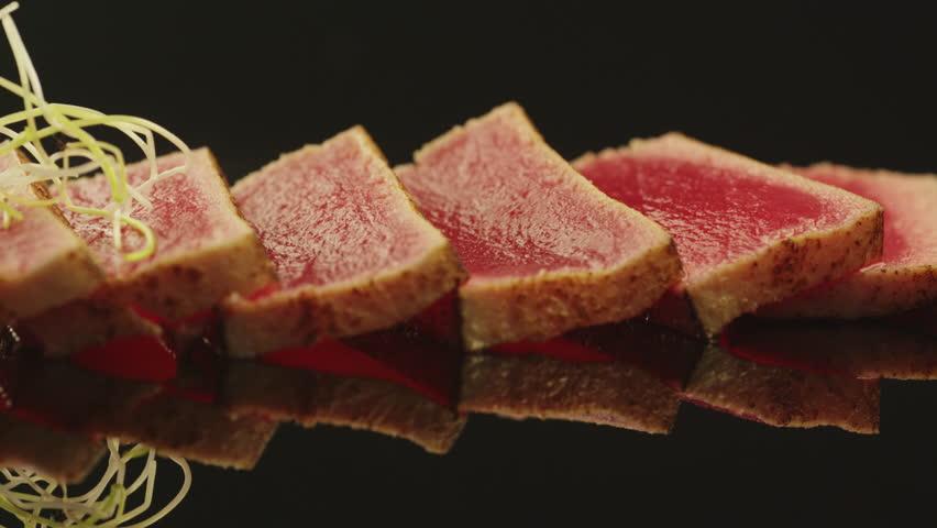 Chef is Garnishing Tuna Fish Fillet in Sushi in Japanese Restaurant. Shot on RED Cinema Camera in 4K (UHD).