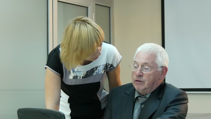 Businesswoman and elderly businessman working in office with computer 1 | Shutterstock HD Video #10814486