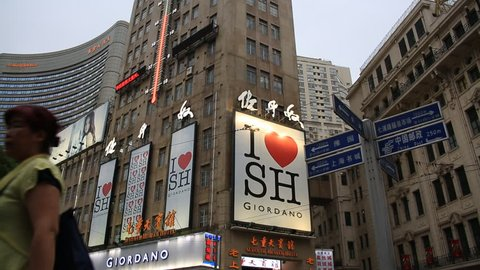 SHANGHAI, CHINA - CIRCA JUNE 2015 :  Giordano advertising sign on the shopping center wall at Shanghai Nanjing Road in Shanghai, China. 