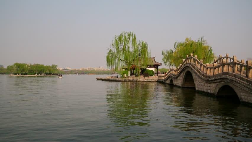 Chinese traditional arch bridge on Daming lake, Jinan, China #10830095