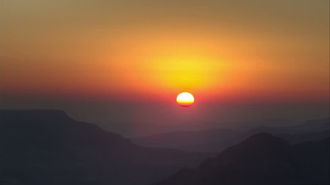 Time lapse of sun rising over the foothills of Drakensberg mountains, Royal Natal National Park,South Africa
