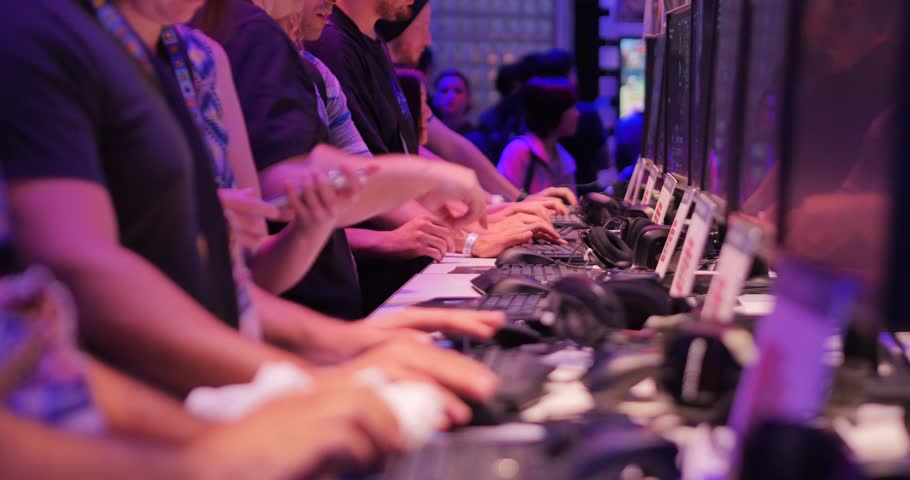 LOS ANGELES - June 17: Gamers testing demo video games at E3 2015 expo. Electronic Entertainment Expo, commonly known as E3, is an annual trade fair for the video game industry. 4K UHD | Shutterstock HD Video #10864217
