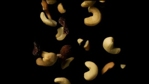 Mixed Nuts Falling In Slow Motion Dark Background 1500fps