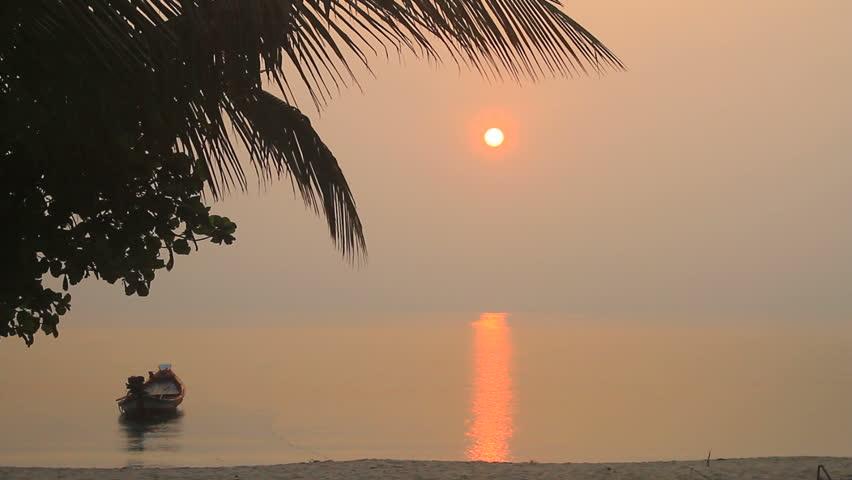 Beautiful sunrise on beach and tropical sea in summer | Shutterstock HD Video #10914470
