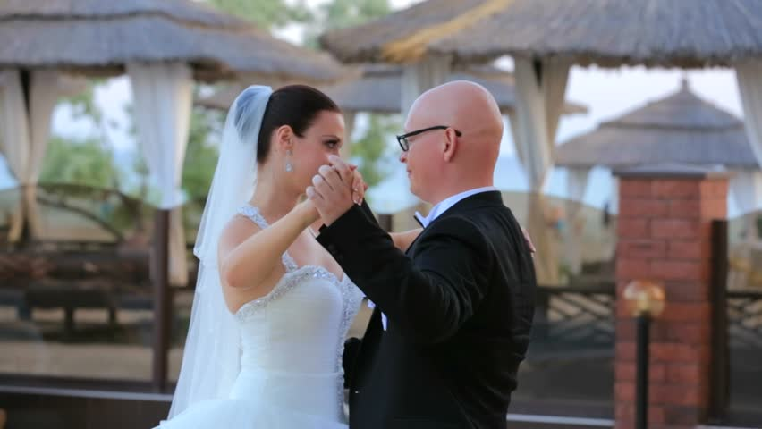 Newlyweds Dancing After The Wedding Ceremony