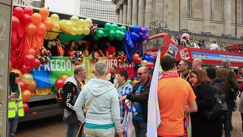 People on the trucks and gathering around waiting for Birmingham Gay Pride, England 2015 celebration to begin. Dancing to the music.