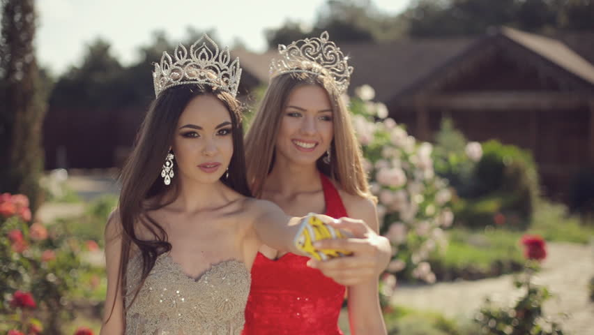 Stock video of two girls in evening gowns and | 10973702 | Shutterstock