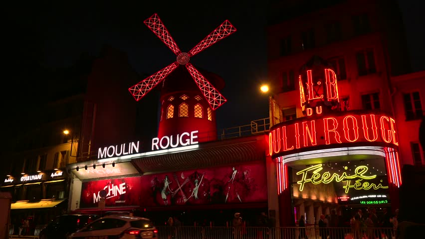 PARIS - May 10: The Moulin Rouge by night, on May 10, 2015 in Paris, France. Moulin Rouge is a famous cabaret built in 1889, located in the Paris red-light district of Pigalle. ULTRA HD 4K, real time