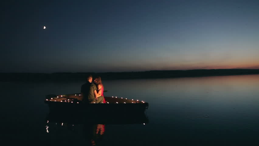 Image result for couple on the lake in a boat in the night