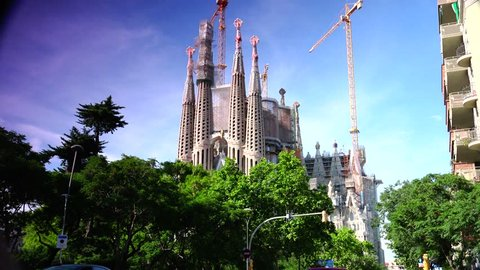 BARCELONA, CATALONIA - JULY 14: Sagrada Familia in July 14, 2013 in Barcelona, Catalonia. Famous Church building is begun in 1882 and completion is planned in 2030, Ultra hd 4k, real time