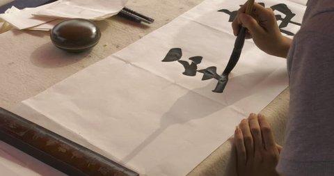 4K - TIANJIN, CHINA - CIRCA AUGUST, 2015: Calligrapher Writes on Paper.