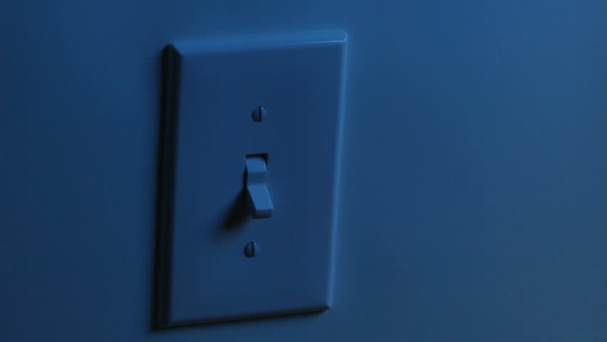 A women's hand flips a light switch on, and then turns it off. Two different