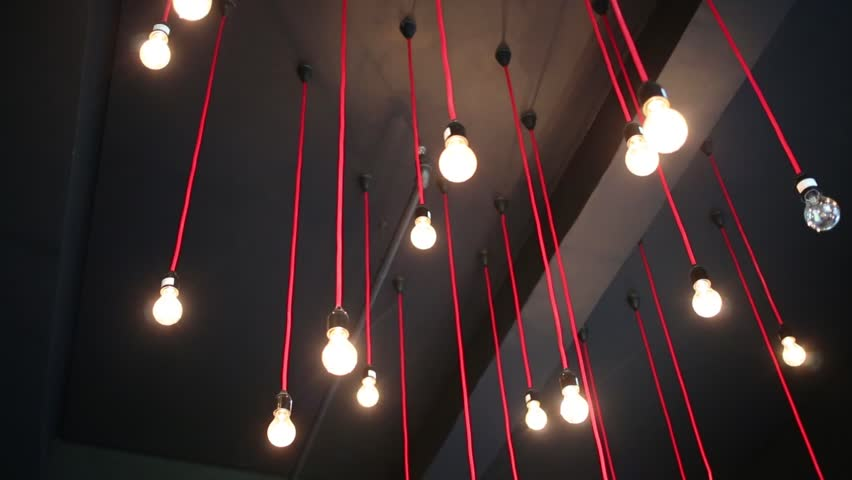 Ceiling With Hanging Lamps With Red Wires In Dark Room Stock ...