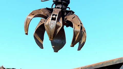 Crane With Open Claw, Metal Recycling Junkyard,slow motion, high speed camera