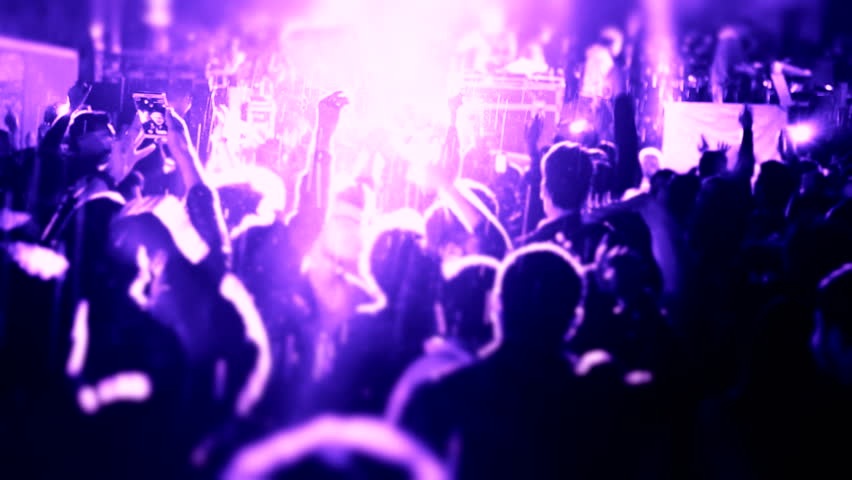 Cheering fans life concert seamless Iconic night rock concert crowd cheering hd speed Night rock concert People cheer move lift clap their hands unison against strobing stage lights Computer generated