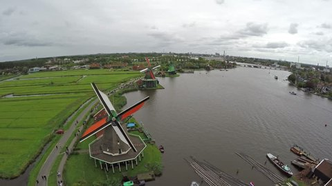 Zaandam Zaanse Schans aerial bird eye helicopter view of the windmills one of the most popular tourist attractions in Netherlands Holland exists of wooden windmills barns houses museum turning blades