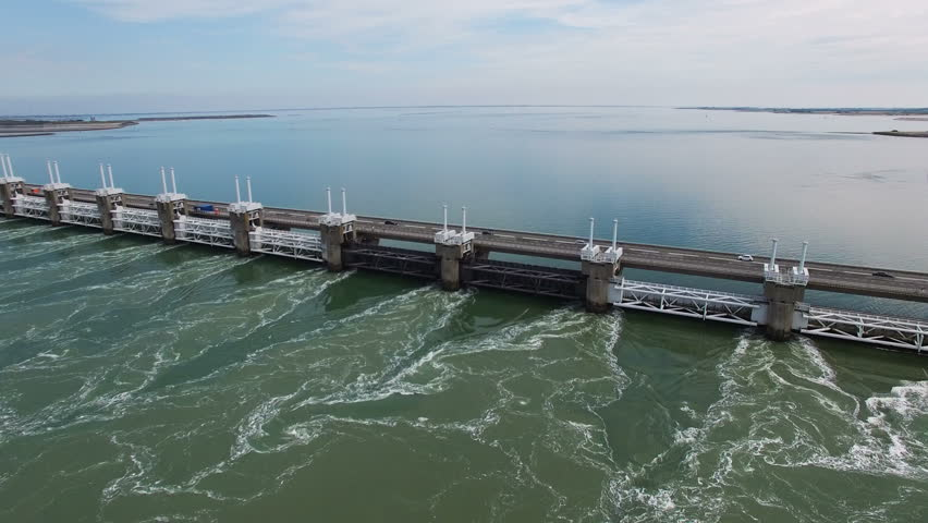 2016 Aerial Video (Ultra HD) of the famous Dutch Delta Works. Seawater barriers engineered  for sea level protection. Camera: Steady height & view moving to the left.