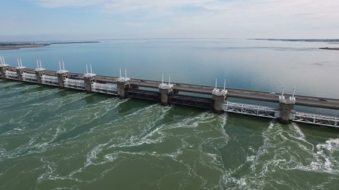 HQ Aerial Drone Video (Ultra HD) of the famous Dutch Delta Works. Seawater barriers engineered  for sea level protection. Camera: Steady height & view moving to the left.