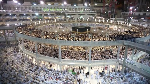 Saudi Arabia - June 30, 2015: Muslim pilgrims circumambulate the Kaaba (Kaabah) at Masjid al Haram Mosque June 30, 2015 in Mecca, Kingdom of Saudi Arabia. Muslims all around face the Kaaba during prayer time.