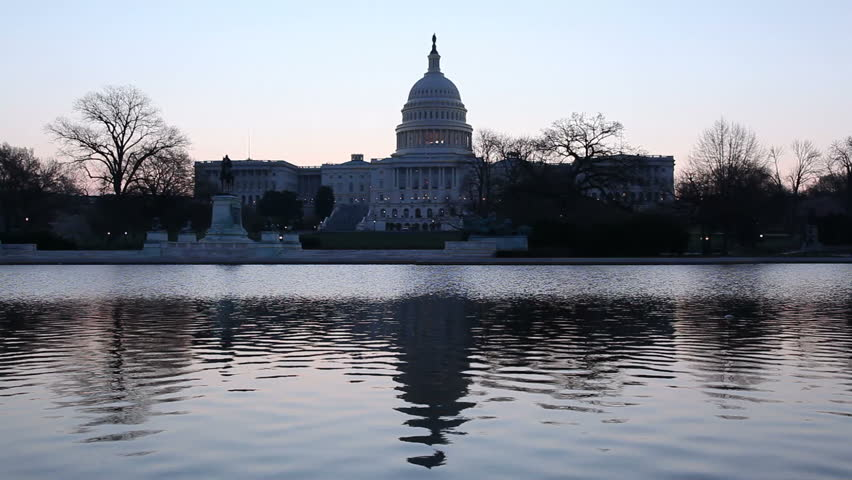 Dawn at the Capitol as the dome is reflected in the reflecting pool in front of the Senate building