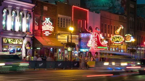 NASHVILLE - AUGUST 13: (Timelapse/Zoom-in) People and vehicular traffic travel on Lower Broadway visiting Honky-tonks and other tourist attractions in on August 13, 2015 in Nashville, Tennessee.