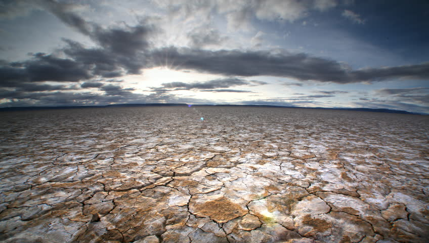 Dry, cracked earth and clouds, Alvard Desert, Oregon